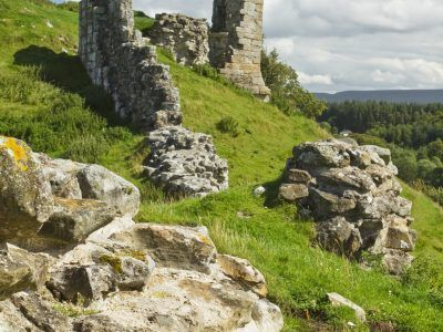 The ruined walls of Harbottle Castle in the Northumberland National Park