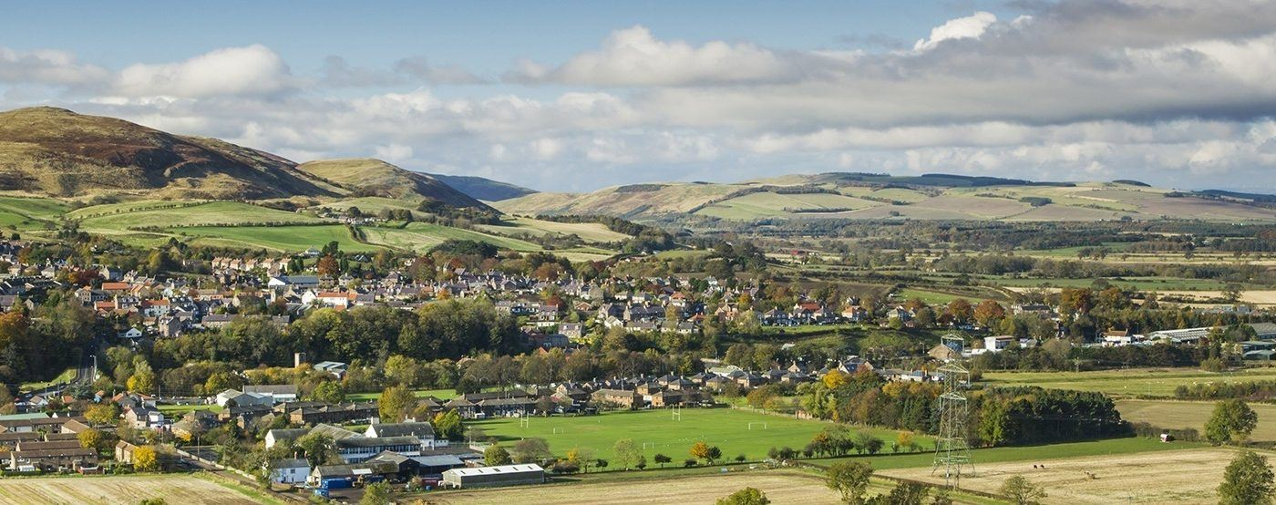 The town of Wooler with the Cheviot range of hills behind.