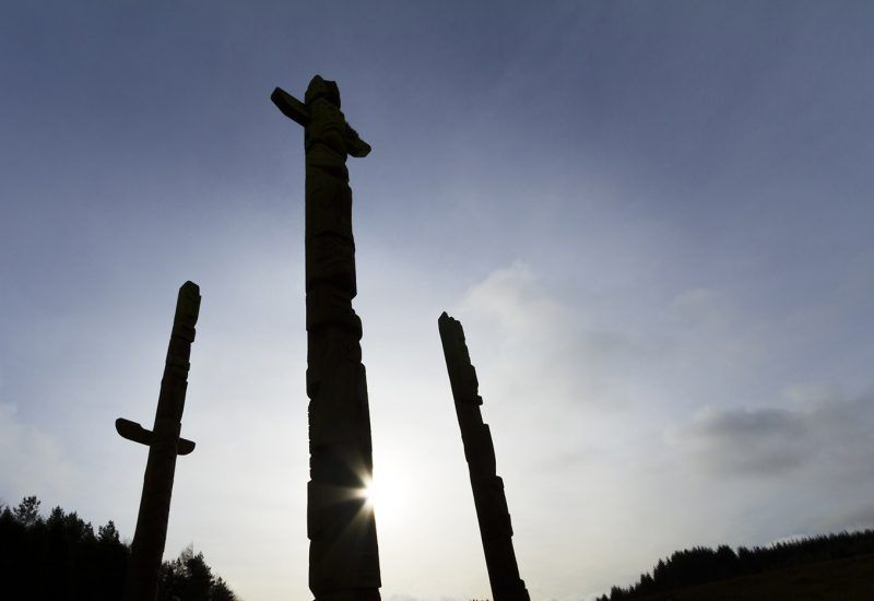 Three totem poles that overlook the village of Stonehaugh