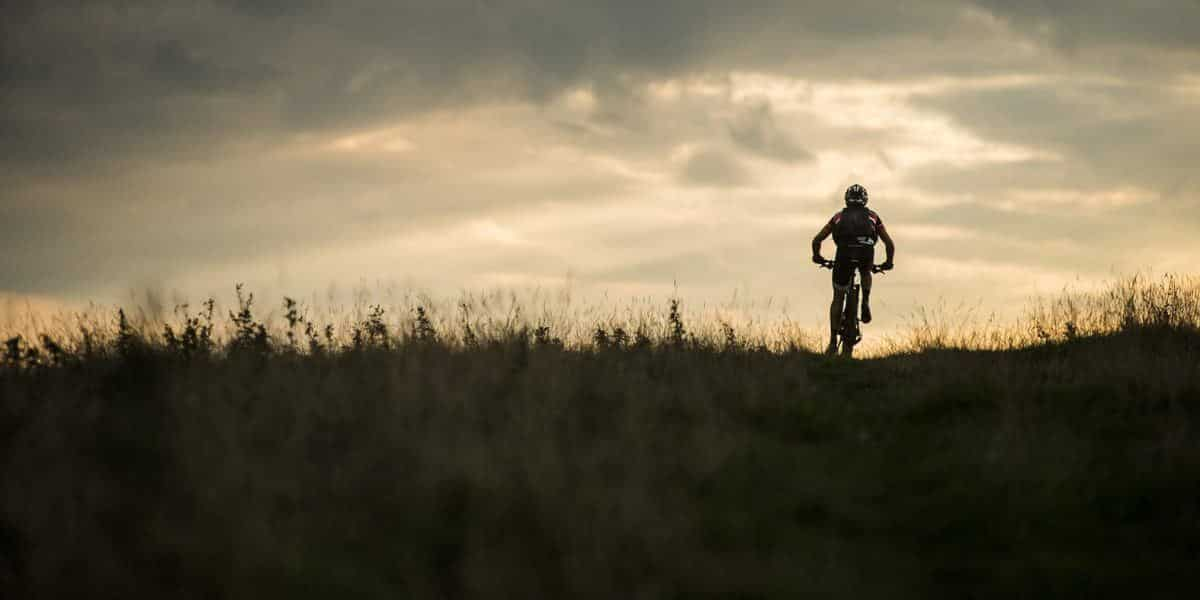 A cyclist gets active on the Sandstone Way in Northumberland National Park