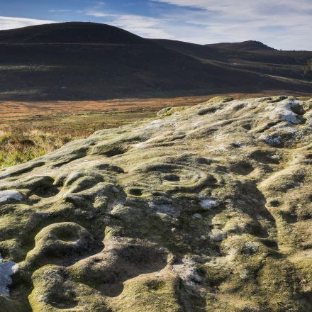 Cup and Ring marked rock on Lordenshaws near Rothbury, Northumberland, England