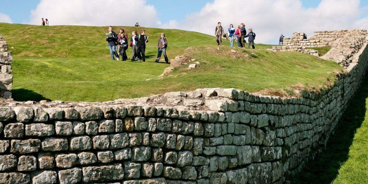 Children visiting the ruins of Housesteads Roman Fort