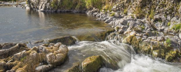 The waters of the River Coquet near The Knock and Shillmoor Farm, Northumberland, England