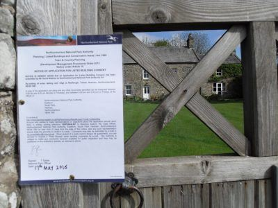 A planning notice attached to a gate