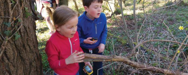 Two children geocaching