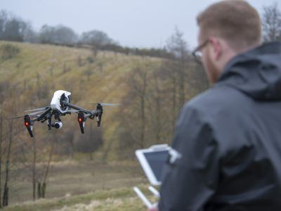 Member of staff flying a drone in the national park