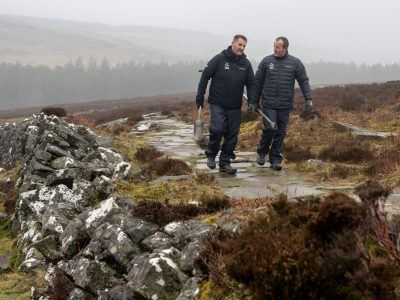 Two National Park Rangers walking in Simonside Hills.