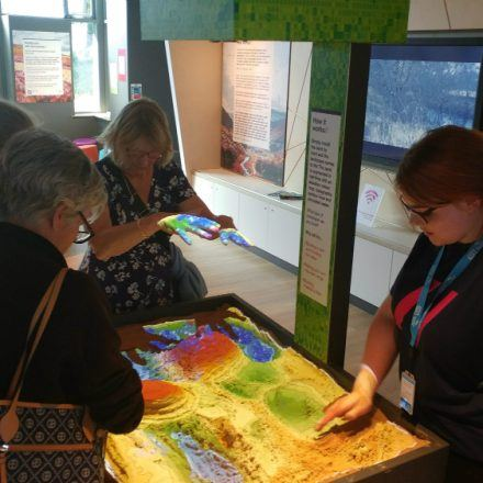 Visitors create their own landscapes in the augmented reality topographic sandbox.