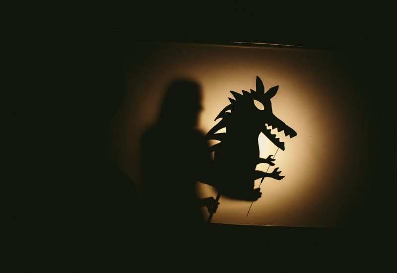 a shadow puppet of a monster