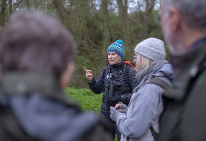 National Park ecologist explaining the Dawn Chorus Walk to a group of participants