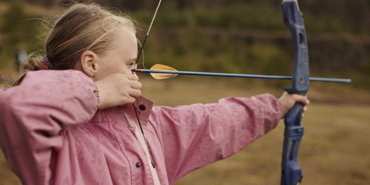 a young girl with a bow and arrow