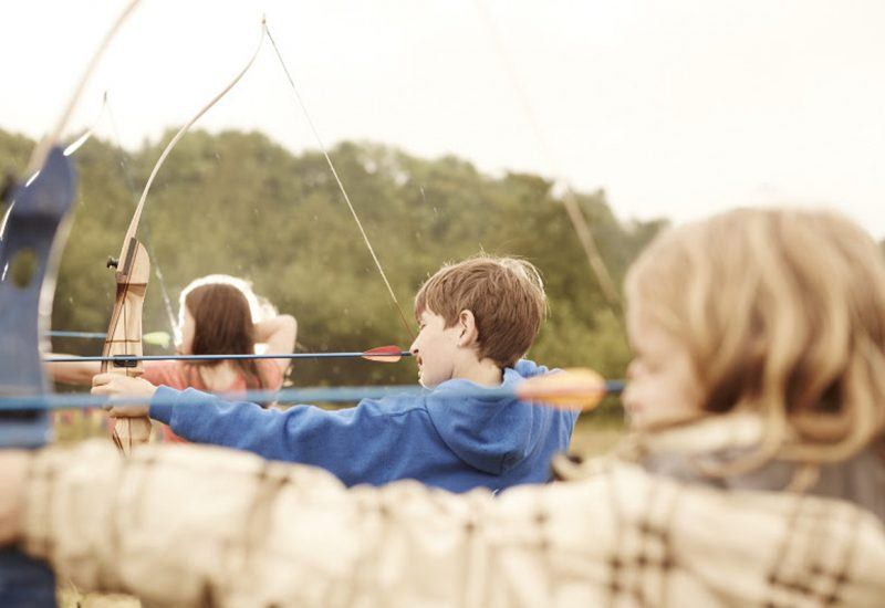 three children with bows and arrows