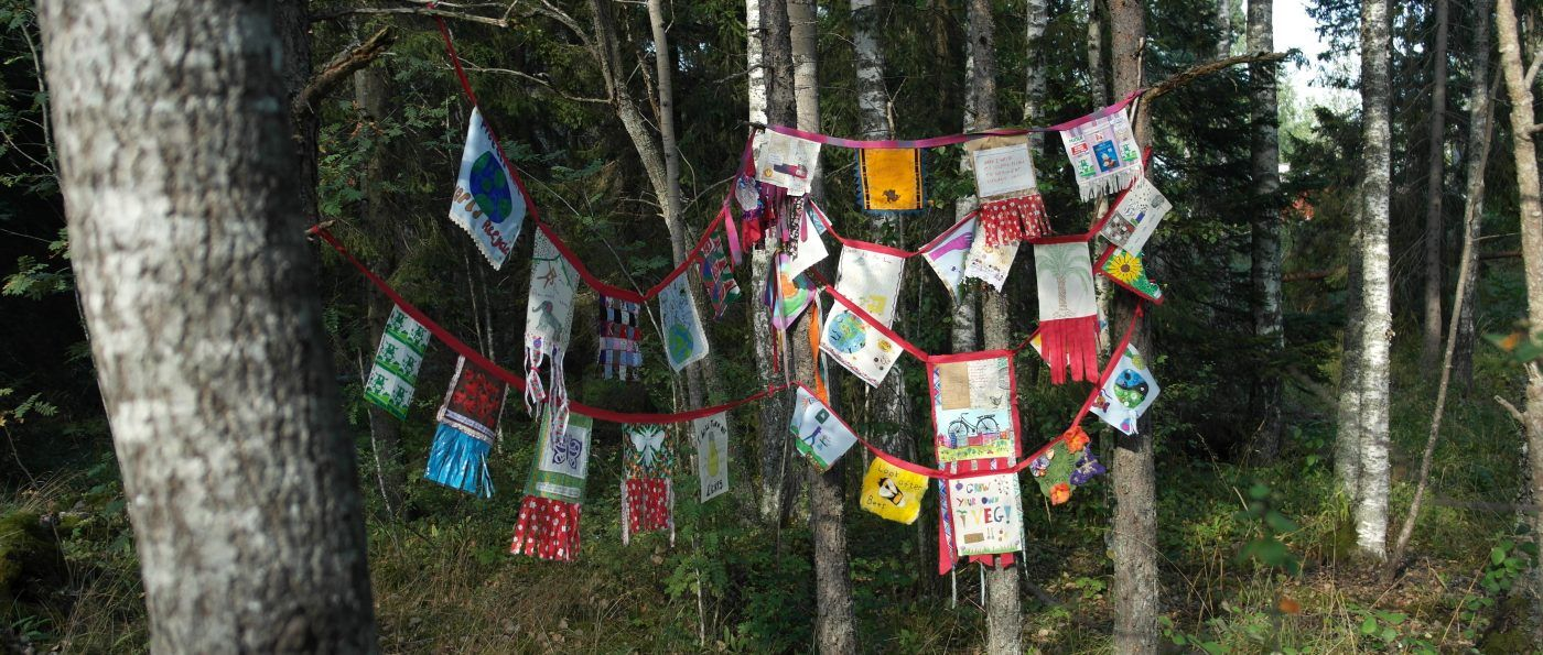 fabric banners hanging from trees