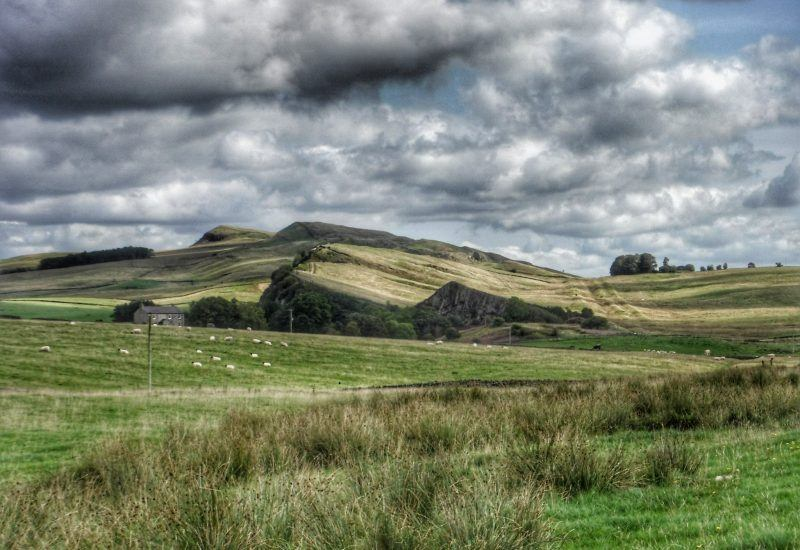 Landscape photo of cawfields with clouds