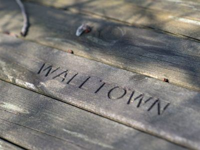 the word walltown carved into a table