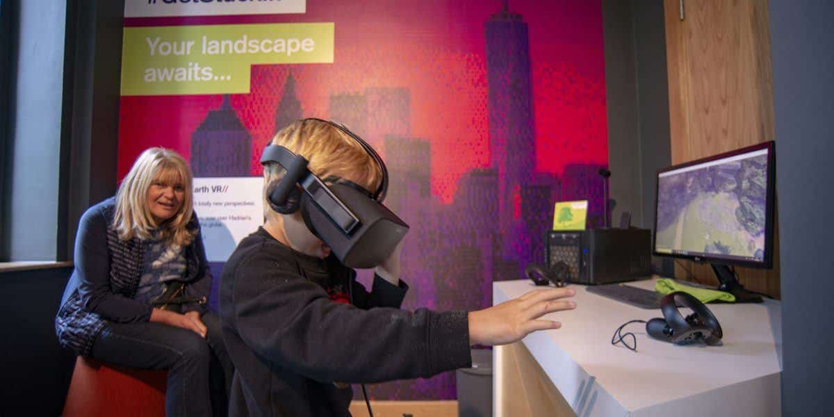 Children using the VR exhibit in the Digital Landscapes Exhibition