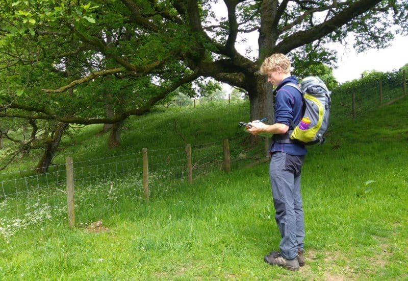 A young volunteer monitoring trees in the national park