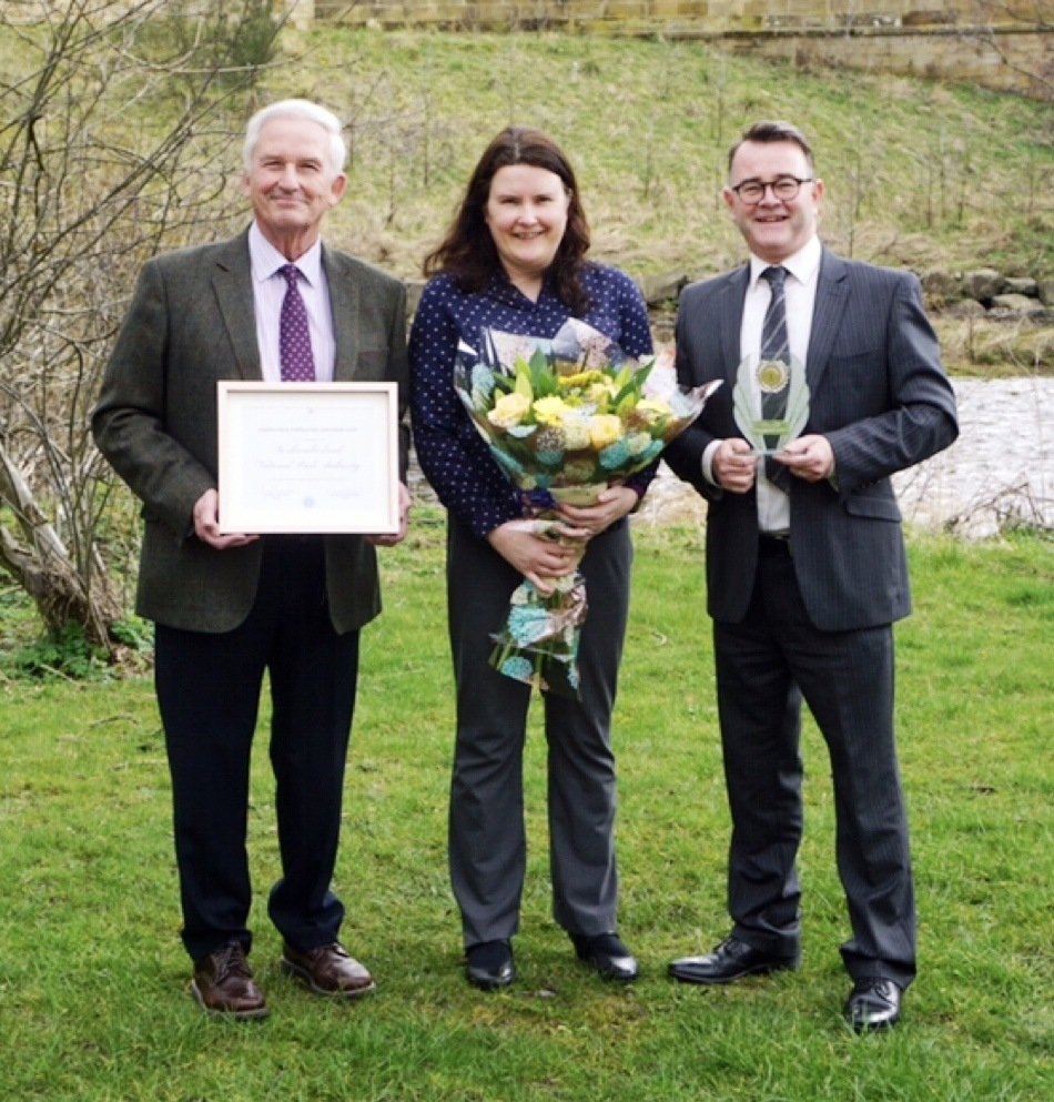 Councillor Glen Sanderson, Chairman of Northumberland National Park with Mary Wallace, HR Manager and Tony Gates, Chief Executive.