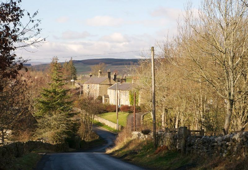 The road entering the village of Greenhaugh