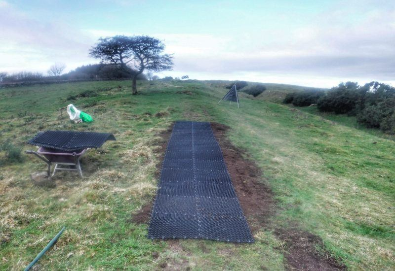 rubber matting laid over collected soil