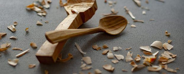two carved wooden spoons