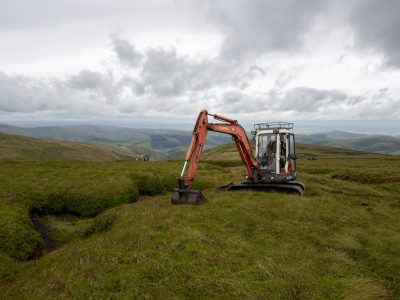 A digger working on peatland restoration on The Cheviot
