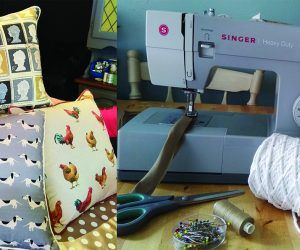 A selection of handmade cushions next to a sewing machine and material.