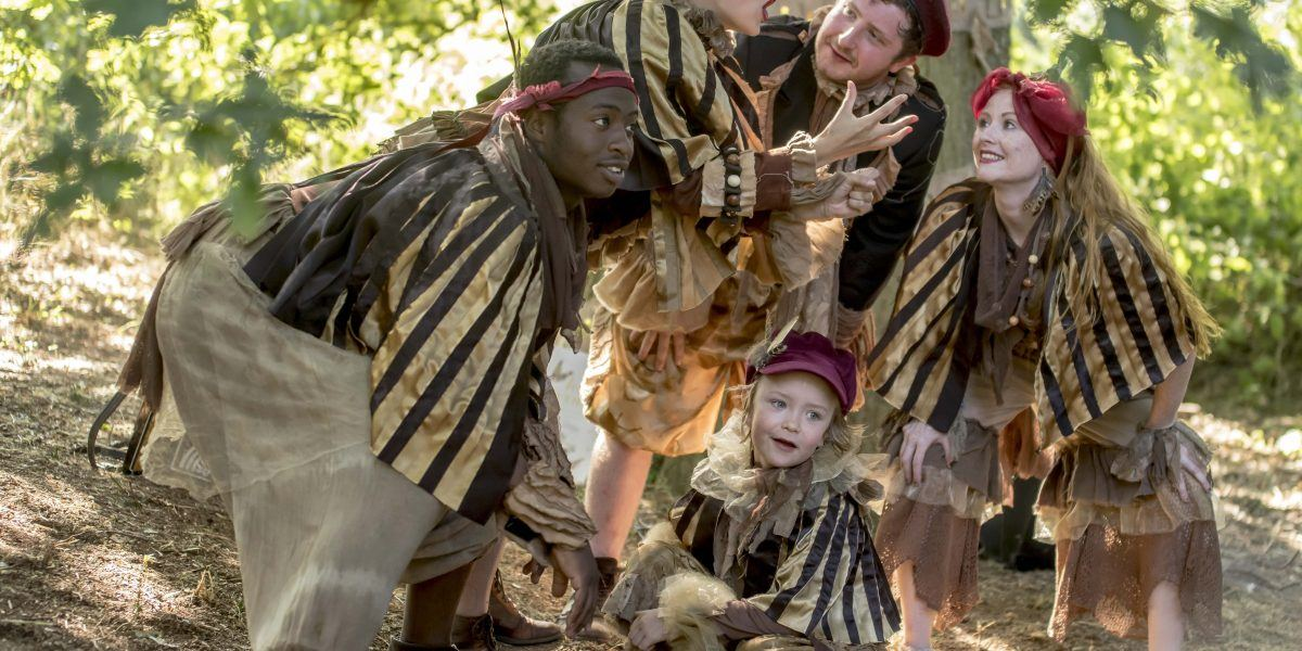 Four adults and a child dressed in costumer perform Lost Words: Told in Gold