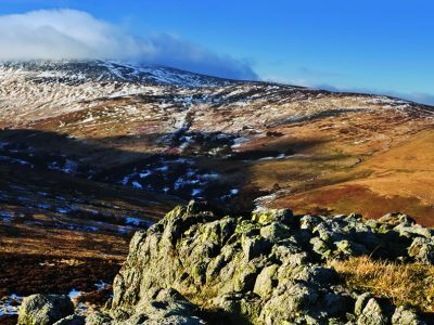 A landscape photograph of Long Crags and Cheviot