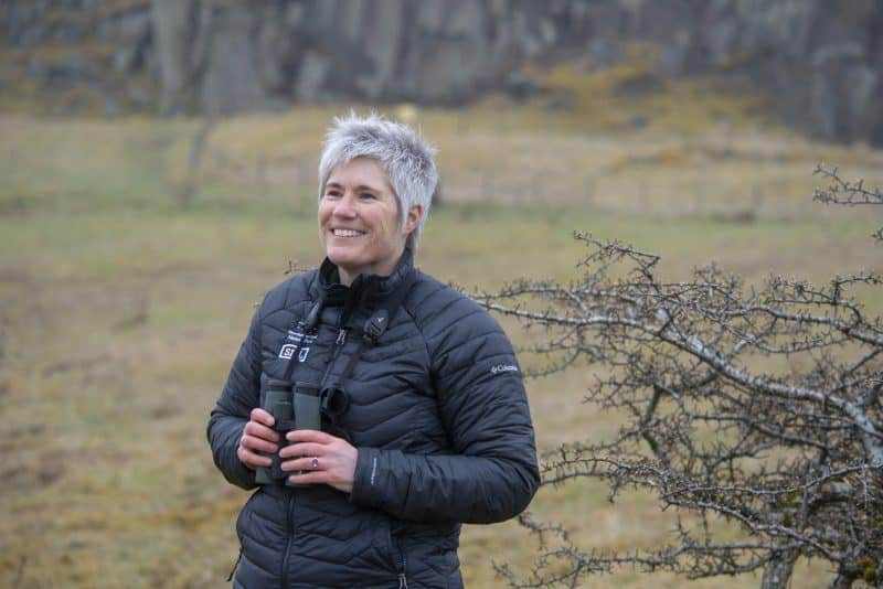 Northumberland National Park Ecologist Gill Thompson holding a pair of binoculars