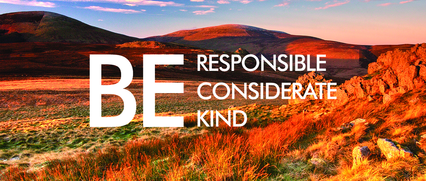"""A view of the Cheviot hills with text overlaid reading """"Be responsible, considerate, kind."""""""