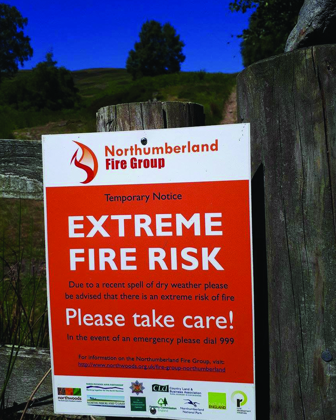 A fire warning sign on a fence